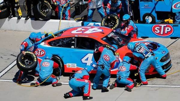 Pit crew in a pit stop