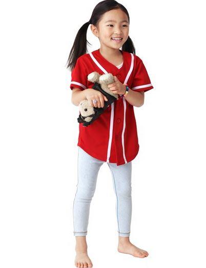 Kid wearing baseball jersey